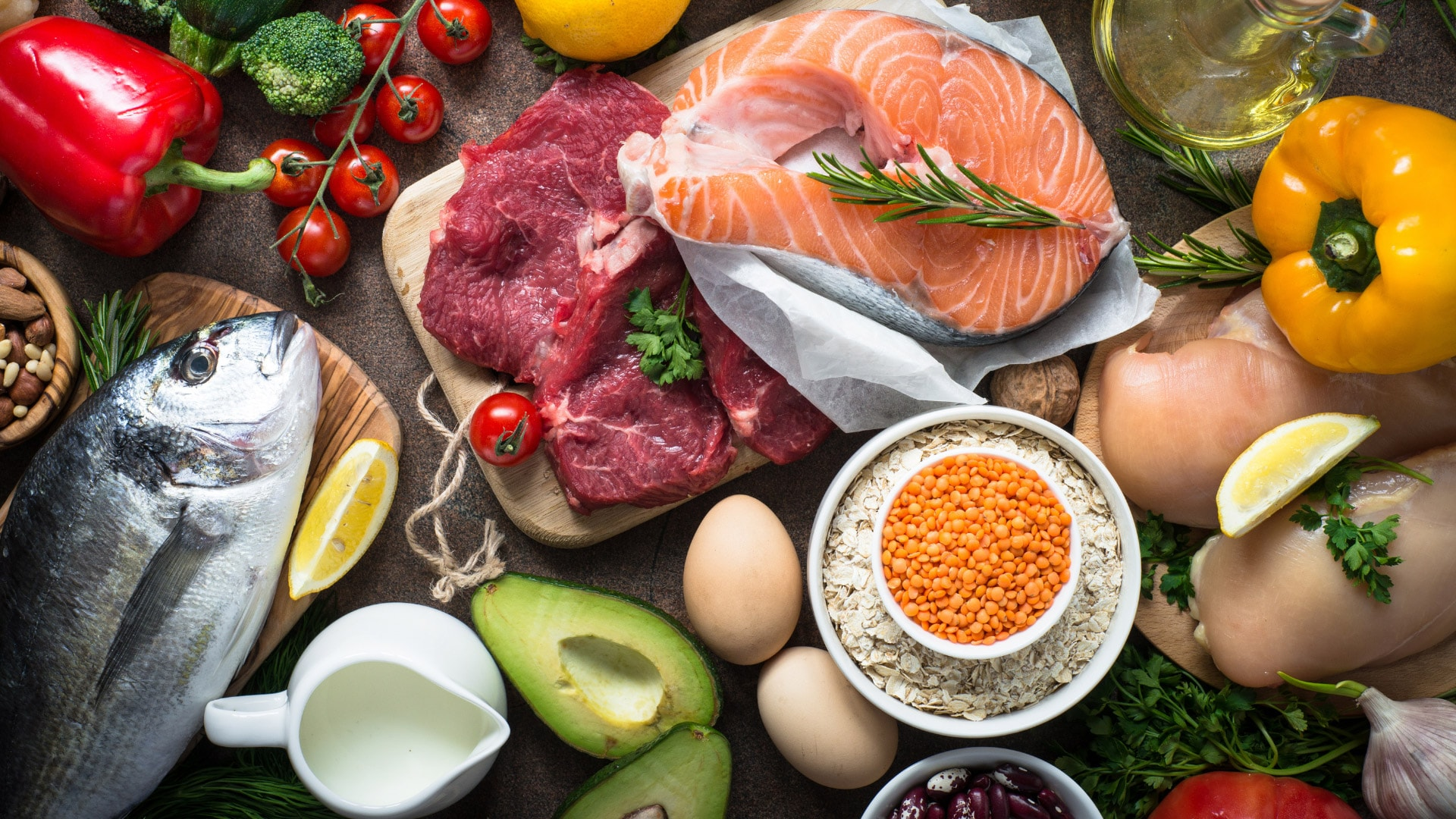 Table of foods high in essential nutrients including fish, avocados, eggs, and salmon